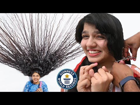 Cutting the world's LONGEST HAIR - Guinness World Records