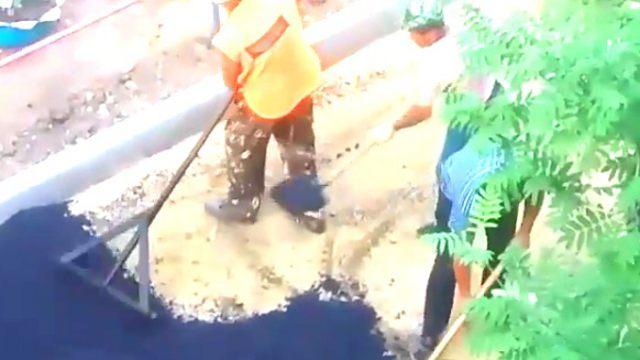 Жительницу Костаная заинтересовала технология укладки асфальта на песок во дворе