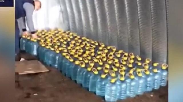 Видео: Житель Костаная хранил в своем автомобиле тонны контрафактного алкоголя